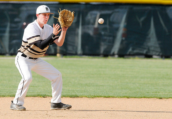 Don Knight   The Herald Bulletin<br /> Daleville's Max Stecher fields the ball as the Broncos hosted the Lapel Bulldogs on Thursday.