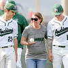 Don Knight | The Herald Bulletin<br /> Pendleton Heights math teacher Anne Plovick joins baseball players Hunter Thompson (25) and Evan Douglas (11) onto the field as the Arabians players recognized the teachers that have influenced them the most during Teacher Appreciation Week on Wednesday. The Arabians hosted the Anderson Indians, read about the game in today's Sports section.