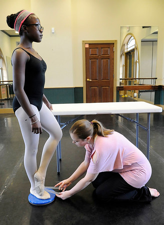 Don Knight | The Herald Bulletin<br /> Jayma Lallathin measures how far Annabell Mwoyna can turn her foot at the Anderson Young Ballet Theatre on Wednesday.