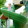 Don Knight | The Herald Bulletin<br /> Aria Kemp, 4, slides down the new slide at Pulaski Park donated by Anderson's Rotary Club as part of their centennial celebration on Friday. Rotary was part of the effort to bring a Born Learning Trail to the park in 2010 and wanted to add to that legacy with the addition of the slide according to local President Leroy Quashie.