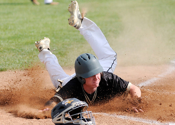 Don Knight | The Herald Bulletin<br /> Daleville's Max Stecher slides safely into home as the Broncos take an early 2-0 lead over the Shenandoah Raiders on Thursday.