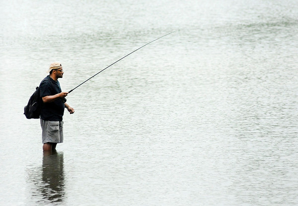 Don Knight   The Herald Bulletin<br /> An angler wades into the water at Shadyside Lake Friday afternoon to try his luck. The weekend forecast includes more chances for rain.
