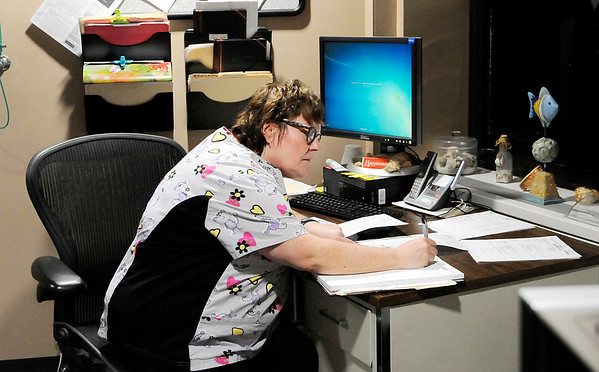 Don Knight | The Herald Bulletin<br /> Sleep Lab Technologist Connie Brown fills out paperwork at the beginning of her shift at St. Vincent Anderson.