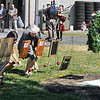 John P. Cleary | The Herald Bulletin<br /> Family members of Pendleton District fallen troopers place flowers at their photographs during the annual Indiana State Police Memorial Service held Thursday.