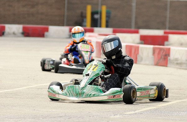 Don Knight | The Herald Bulletin<br /> Joshua Schneider leads the Comet Kart Yamaha Senior Can feature during the 24th annual Mayor's Cup Grand Prix at Mounds Mall on Saturday. Schneider went on to win the race.