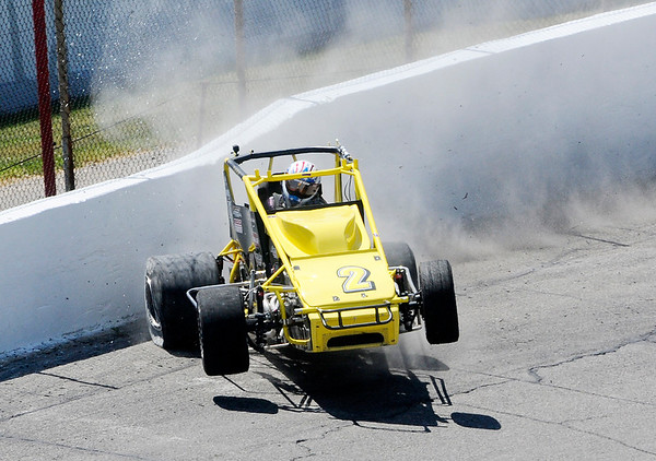 Don Knight   The Herald Bulletin<br /> Dave Osborn gets into the wall on a qualifying run for the Little 500 at the Anderson Speedway on Thursday.