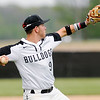 Don Knight | The Herald Bulletin<br /> Lapel's Cameron Holycross throws to first after fielding the ball as the Bulldogs hosted the Sheridan Blackhawks on Friday.