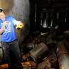 Don Knight | The Herald Bulletin<br /> Tim Bowers looks at a bottle of what appears to be aspirin while exploring a former fallout shelter in Anderson.
