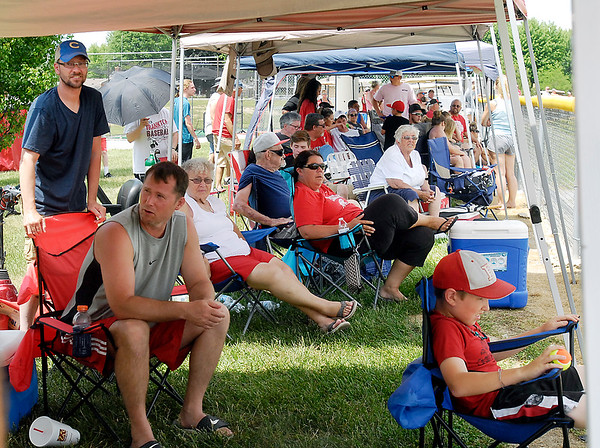 John P. Cleary | The Herald Bulletin<br /> This Memorial Day found people in their lawn chairs, under the canopies trying to stay cool as they watched their favorite teams play in the high school baseball sectionals around the area.