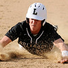Don Knight | The Herald Bulletin<br /> Lapel's Connor Gill slides into third as the Bulldogs faced the Daleville Broncos on Thursday.