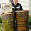 Don Knight | The Herald Bulletin<br /> Tim Bowers found some old water cans and survival crackers while cleaning out a fallout shelter.