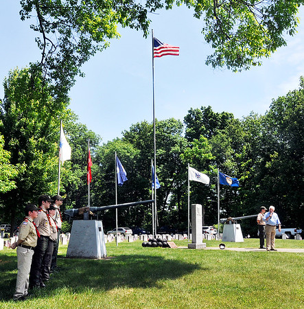 John P. Cleary | The Herald Bulletin<br /> The flags of each of the military branches were flown as they were recognized during the annual Memorial Day remembrance service conducted by Boy Scout Troop 301 at Maplewood Cemetery.