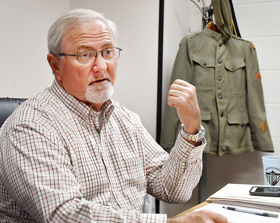 John P. Cleary   The Herald Bulletin <br /> Madison County Veterans Service officer Bruce Dunham talks about his grandfathers WW I experiences with some of his items from his time in service, including his protective gas mask, uniform, dog tags, helmet, and also a German helmet.