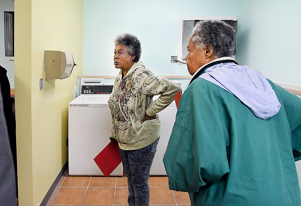 John P. Cleary | The Herald Bulletin <br /> Westvale Manor residents residents got their first look at the new laundry facilities at the apartment complex Monday afternoon. The apartment complex  has been without laundry facilities for several years.