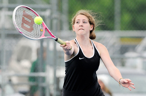 Don Knight   The Herald Bulletin<br /> Makayla McDole returns a volley as McDole and Chloe Renihan faced Westfield's Katy Zaladek and Maddie Heilman at No. 2 doubles on Monday.