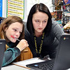 John P. Cleary | The Herald Bulletin <br /> Daleville Elementary School social worker Amber Fox will drop into classrooms throughout the day to checkup and to see students. Here she assists fifth-grader Justis Reel with a math question while Fox was in David Hubble's classroom.