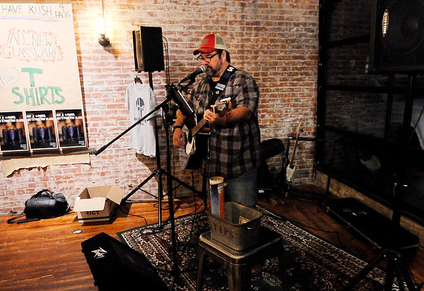 Don Knight | The Herald Bulletin<br /> Jeff Ash plays at Pax Verum Brewing in Lapel on Saturday.