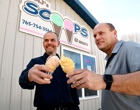 John P. Cleary   The Herald Bulletin  <br /> Matt Rastetter and Jeremy Parker toast each other with ice cream in front of their new ice cream shop in Frankton called MJ's Scoops & more.  The store is located at 303 Lafayette Street and has been opened now for about a month.
