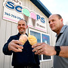 John P. Cleary | The Herald Bulletin  <br /> Matt Rastetter and Jeremy Parker toast each other with ice cream in front of their new ice cream shop in Frankton called MJ's Scoops & more.  The store is located at 303 Lafayette Street and has been opened now for about a month.