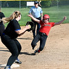 John P. Cleary | The Herald Bulletin <br /> As APA's Shaylynn Swinford turns with the ball, Liberty Christian's Mady Rees starts her slide into third base running on a passed ball in the first inning of their game Monday evening. Rees slid under the tag and was called safe by the umpire.