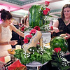 John P. Cleary | The Herald Bulletin <br /> Flower-laden slippers were the centerpiece of the horsd'oeuvre table at the third annual Legends Ball benefiting Stripped Love.