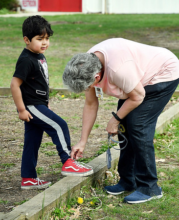 John P. Cleary | The Herald Bulletin <br /> Mary Douramacos helps Liberty Christian Elementary School Pre-K student Jordan Lamb with his shoes as he plays out on the playground during Kids Club after school. Mary is a winner of the 2019 Max Beigh award.