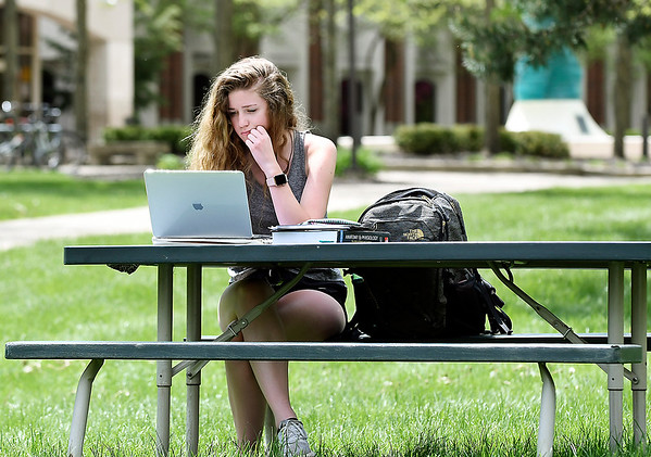 John P. Cleary | The Herald Bulletin <br /> Anderson University freshman Sierra Curtis takes in the warm sunshine Monday afternoon as she studies for her last final exam of the semester outside in the valley. Curtis, a nursing student from Grand Rapids, MI., was preparing for her anatomy class final.