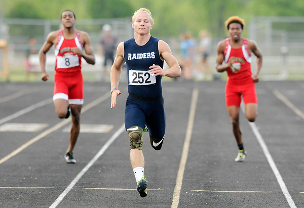 Don Knight | The Herald Bulletin<br /> Shenandoah's Gabe Young wins his heat in the 200 meter dash during the boys track sectional at Mt. Vernon on Friday.