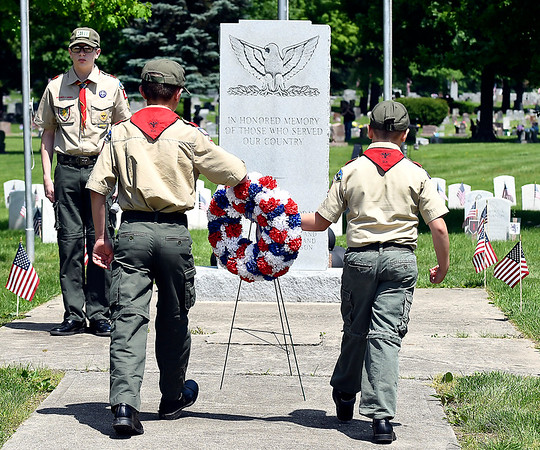 John P. Cleary   The Herald Bulletin <br /> Members of Boy Scout Troop 301 place a memorial wreath at the Veterans Monument Monday during the Memorial Day services at Maplewood Cemetery.