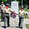 John P. Cleary | The Herald Bulletin <br /> Members of Boy Scout Troop 301 place a memorial wreath at the Veterans Monument Monday during the Memorial Day services at Maplewood Cemetery.