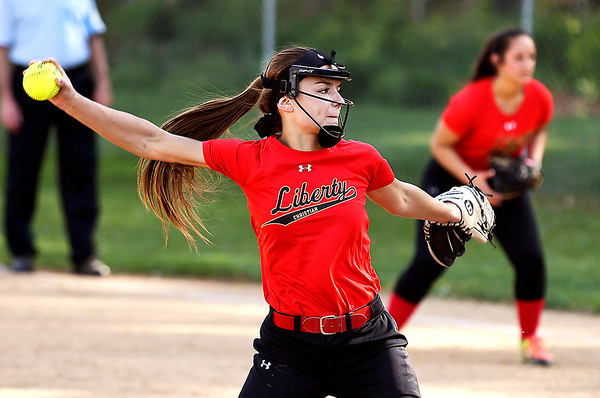 John P. Cleary | The Herald Bulletin <br /> Liberty Christian pitcher Alayna Thomas lets go with another pitch against APA Monday evening.