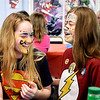 "John P. Cleary | The Herald Bulletin <br /> Highland Middle School students Emily Carlton, 14, and Taylor Beatrice, 14, laugh at each others face paintings during the annual Highland Middle School Life Skills class outing Wednesday at the FOP lodge. This years event had the theme of ""Super Heroes."""