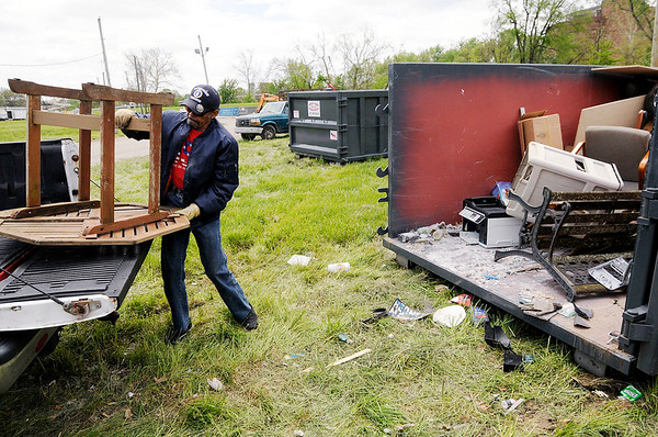 Don Knight | The Herald Bulletin<br /> Allen Coates unloads a table from his truck at Athletic Park during the Annual Rev. J.T. Menifee citywide cleanup on Saturday.