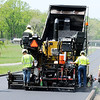 Don Knight | The Herald Bulletin<br /> A crew from E&B Paving resurfaces Townsend Hill at Derby Downs on Wednesday. This was the first time the track has been resurfaced since opening in 1961.