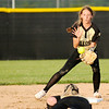 Don Knight | The Herald Bulletin<br /> Lapel's Lily Daniels tosses the ball to Chloe Tucker for a force out as the Bulldogs hosted Tipton in the regional on Tuesday.