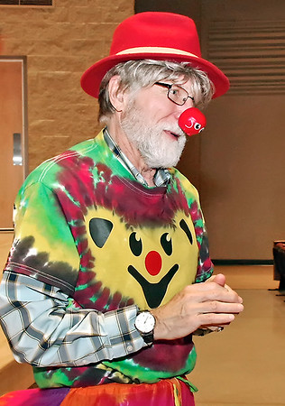 """Mark Maynard   for The Herald Bulletin<br /> Dr. Mark Kane assumes his clown alter ego """"Marcos"""" after the screening of """"ClownVets"""" at Anderson University on Thursday evening."""