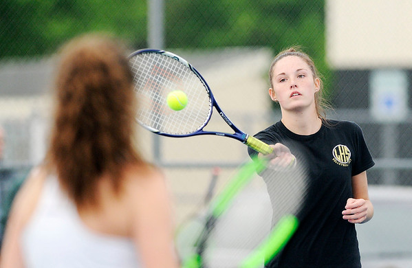 Don Knight | The Herald Bulletin<br /> Zoe Freer sends the ball down the baseline as Freer and Emily Eppert faced Westfield's Maya Raymond and Meredith Carlson in the No.1 doubles match on Monday.