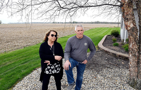 John P. Cleary | The Herald Bulletin <br /> Becky and Curt Harrison aren't happy about part of the proposed 850-acre solar farm being located directly north of their home on CR 450W. The Harrison's moved into their home 44 years ago, the day after they got married.