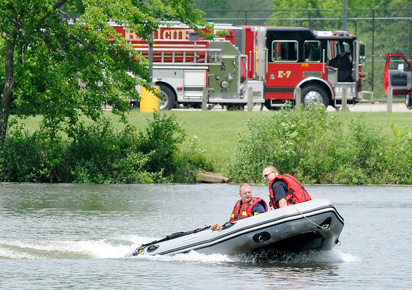 Don Knight   The Herald Bulletin<br /> AFD operates their Zodiac boat during water rescue training at Shadyside on Tuesday.