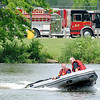 Don Knight | The Herald Bulletin<br /> AFD operates their Zodiac boat during water rescue training at Shadyside on Tuesday.