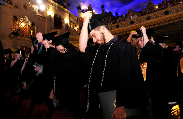 Don Knight | The Herald Bulletin<br /> Students turn their tassel at the end of Ivy Tech's commencement at the Paramount on Tuesday.