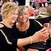John P. Cleary | The Herald Bulletin <br /> Kathi Lower takes a selfie of herself and Luanne Latchaw during the third annual Legends Ball Saturday evening at the Paramount Theatre ball room. The event benefits Stripped Love, a nonprofit organization the assists women survivors of commercial sex trade exploitation and human trafficking.