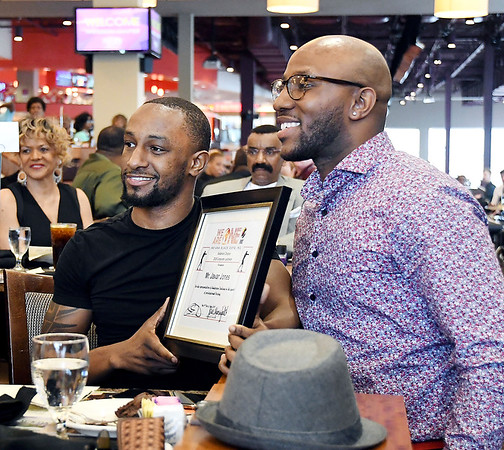 John P. Cleary   The Herald Bulletin <br /> The Anderson Chapter Indiana Black Expo 2019 Corporate Luncheon.<br /> Professional boxer Javar Jones holds his award with presenter Norman Anderson.