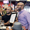 John P. Cleary | The Herald Bulletin <br /> The Anderson Chapter Indiana Black Expo 2019 Corporate Luncheon.<br /> Professional boxer Javar Jones holds his award with presenter Norman Anderson.