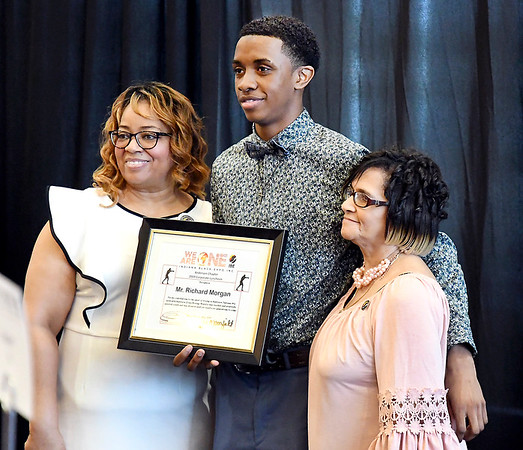 John P. Cleary   The Herald Bulletin <br /> The Anderson Chapter Indiana Black Expo 2019 Corporate Luncheon.<br /> Jan Mansfield and Marilyn Goree pose for photos with Austin Morgan as he accepted the award for his father, Richard Morgan, who founded the Anderson Zion's Boxers.