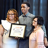 John P. Cleary | The Herald Bulletin <br /> The Anderson Chapter Indiana Black Expo 2019 Corporate Luncheon.<br /> Jan Mansfield and Marilyn Goree pose for photos with Austin Morgan as he accepted the award for his father, Richard Morgan, who founded the Anderson Zion's Boxers.