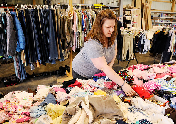 Don Knight   The Herald Bulletin<br /> Amber Burns searches for childrens clothes at a barn sale on Indiana 38 east of Pendleton. The Highway 38 Sale is in its 15th year.