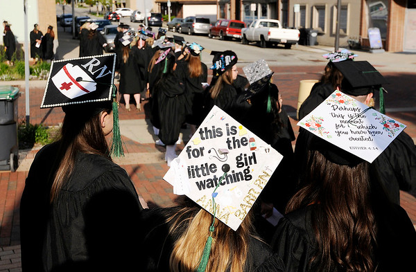 Don Knight | The Herald Bulletin<br /> Students wait for the processional to start for Ivy Tech's at the Paramount commencement on Tuesday.