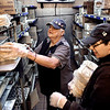 John P. Cleary | The Herald Bulletin<br /> Anna Rice, 65, works with fellow employee Caleb Karkosky with inventory in the walk-in at the Elwood McDonald's.
