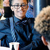John P. Cleary | The Herald Bulletin <br /> Highland Middle School sixth grader Jesiah Harris talks with one of his classmates at the Dr. Martin Luther King Jr. Memorial Commission scholarship luncheon Saturday.